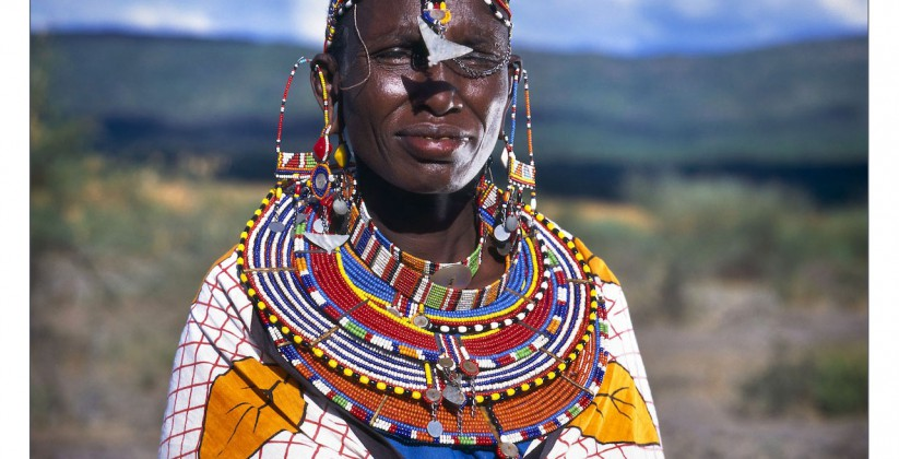 Portrait of a Masai woman in traditional clothes and jewellery in Kenya, Africa